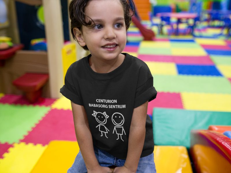 little-kid-wearing-a-round-neck-t-shirt-mockup-while-at-a-playground-a16135