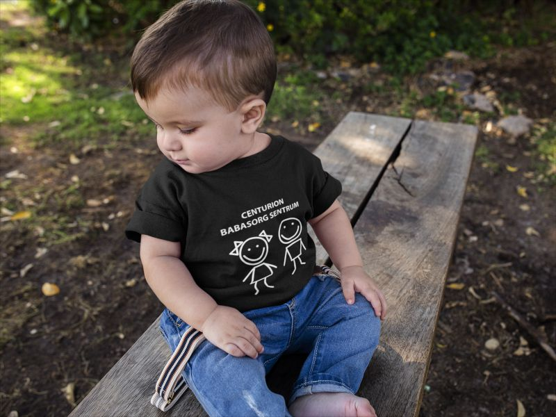 mockup-of-a-baby-boy-looking-down-to-the-floor-while-wearing-a-tshirt-a16086
