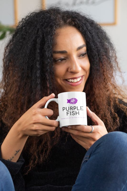 mockup-of-a-curly-haired-woman-with-an-11-oz-mug-in-her-hands-33174
