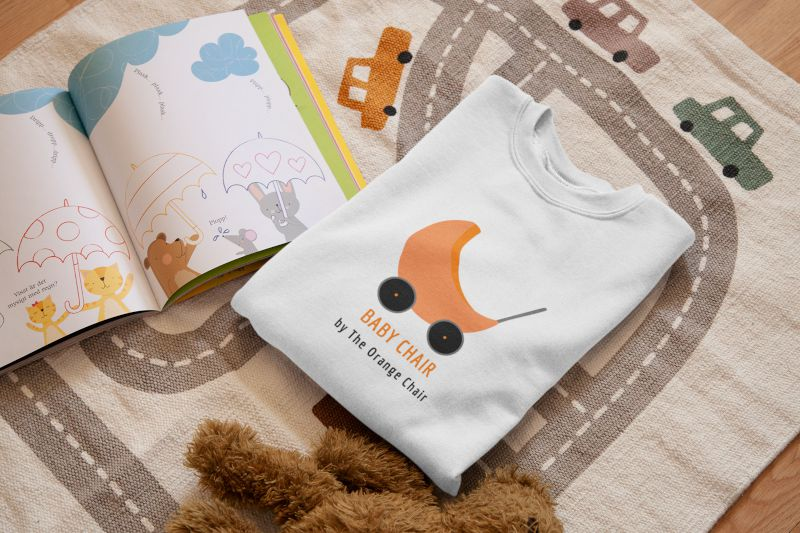 mockup-of-a-folded-t-shirt-on-a-children-s-room-mat-33995
