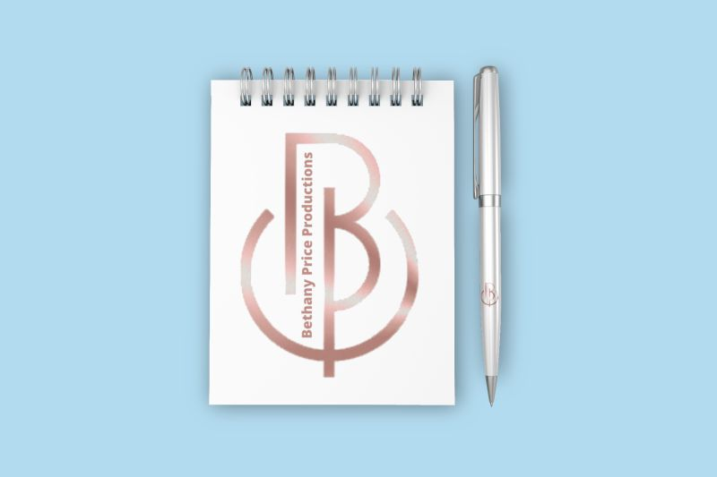 mockup-of-a-small-spiral-notebook-and-a-pen-against-a-minimalistic-surface-921-iu