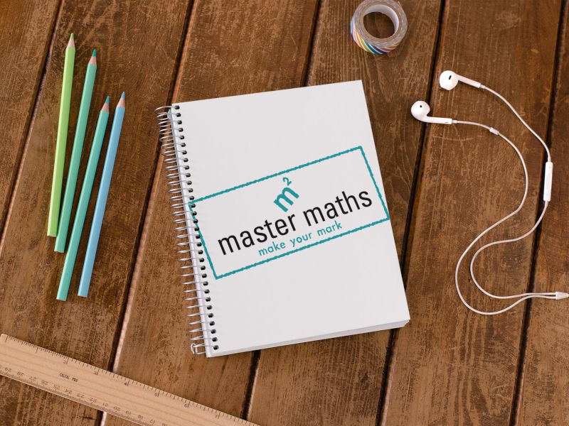 mockup-of-a-spiral-notebook-lying-on-a-wooden-table-next-to-some-colored-pencils-29954